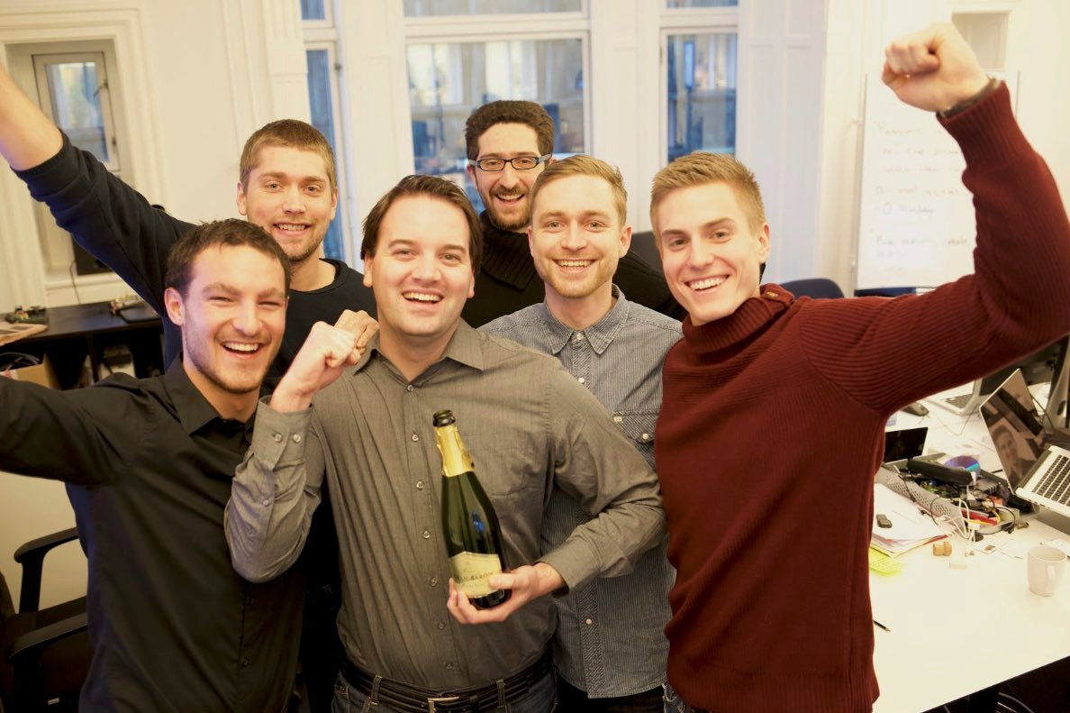 A group of Airtame employees celebrating the success of the crowdfunding campaign
