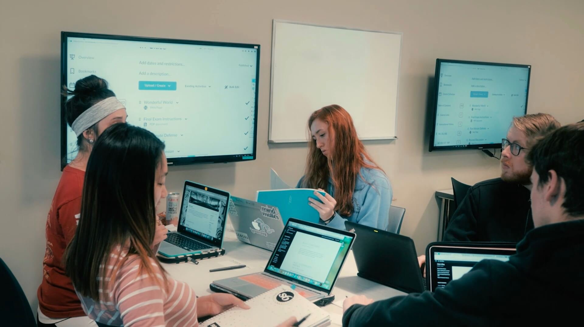 Students stream wirelessly to two different screens inside of a learning space