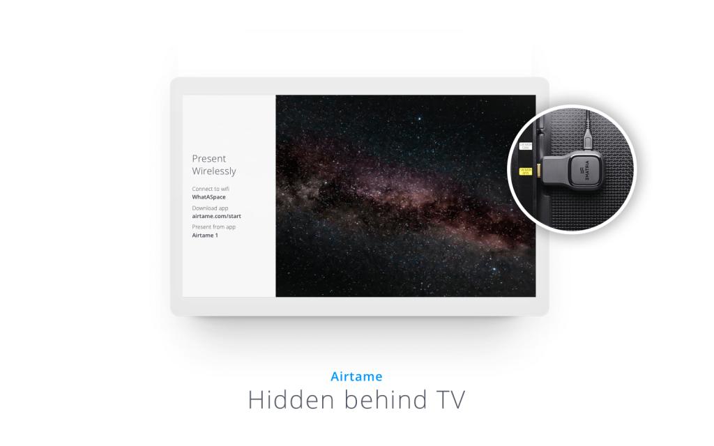 Airtame 1 device hidden behind a TV